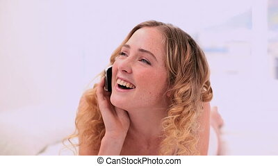 Laughing blonde model making a phon