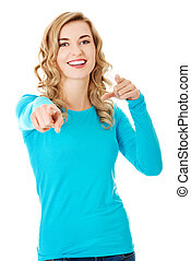 Laughing blonde woman pointing on you