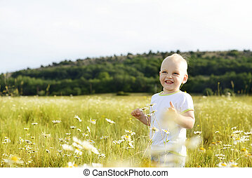 laughing boy in field