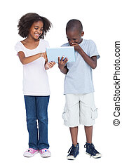 Laughing boy looking at tablet pc