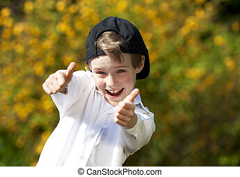 laughing boy posing thumbs up