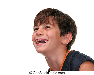 Ten year old boy with braces laughing. Shot on white.