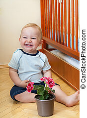 Laughing boy with flower