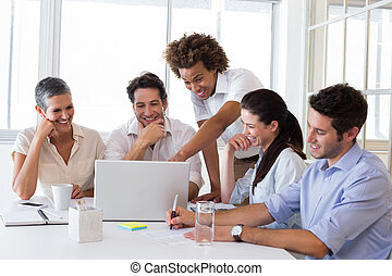 Laughing business people working together