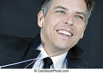 Laughing Businessman Wearing Headphones