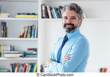 Laughing businessman with grey hair and necktie