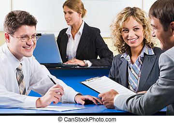 Laughing businesspeople