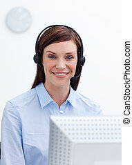 Laughing businesswoman with headset on