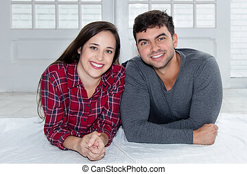 Laughing caucasian love couple at home