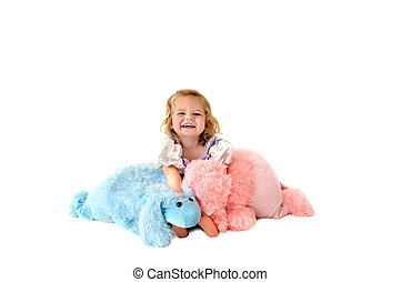 Laughing child holding toy poodles