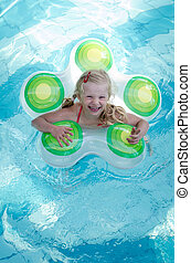 laughing child in swimming pool