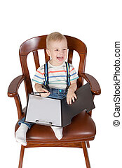 Laughing child sitting in a chair