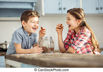 Laughing children having some cookies