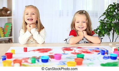 Laughing children look into camera