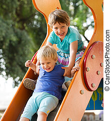 laughing children on slide