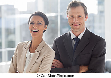 Laughing colleagues in office