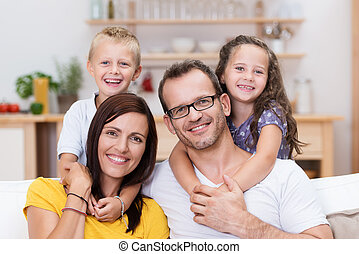 Laughing confident young family