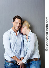 Laughing Couple Against Gray Background