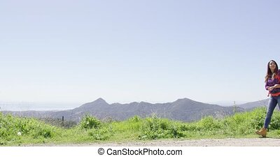 Laughing couple in mountains - Young laughing couple wearing...