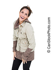 Laughing cute brunette in winter fashion posing for camera