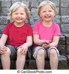 Laughing cute identical twins - Laughing cute identical...
