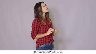 Laughing DIY woman holding up a tape measure