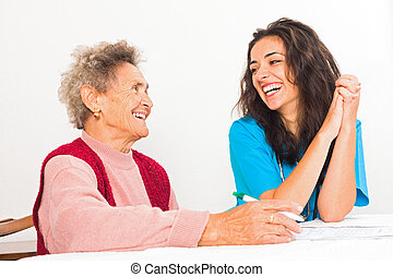 Laughing Elderly and Nurse - Happy elderly lady laughing...
