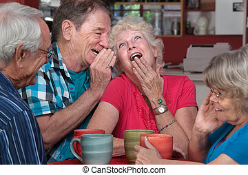 Laughing Elderly Couple with Friends