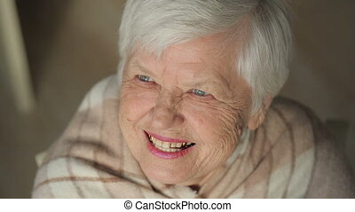 Laughing elderly woman - Portrait of happy elderly woman