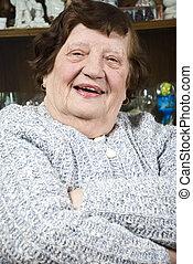 Laughing elderly woman
