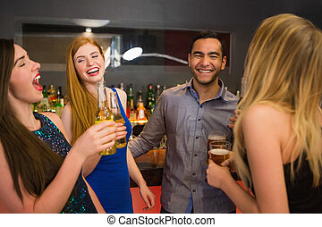 Laughing friends drinking beers