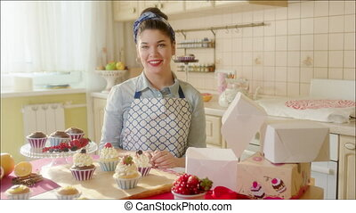 Laughing girl in the kitchen