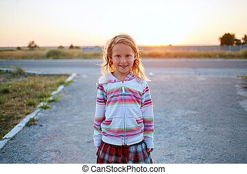 girl looks into the camera