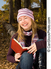 laughing girl with a book