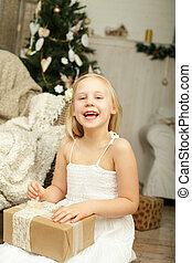 Laughing girl with Christmas gift