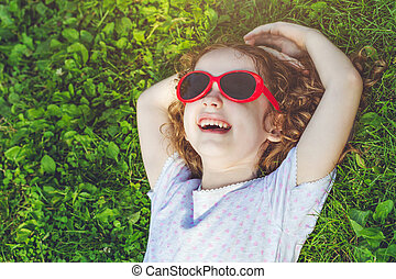 laughing girl with glasses