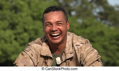 Laughing Hispanic Male Soldier Wearing Camo