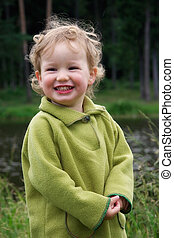 Laughing kid in green
