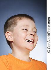 Laughing kid in orange shirt