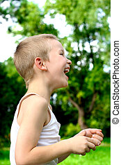 laughing kid stand in the park