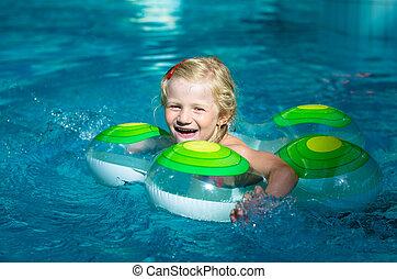 laughing kid swimming