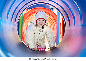 laughing little baby girl in tube