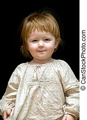 Laughing little baby in home dress  on black background