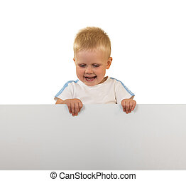 Laughing little boy holding a banner, isolated on white