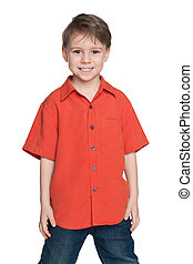 Laughing little boy in a red shirt