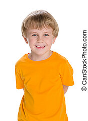 Laughing little boy in a yellow shirt
