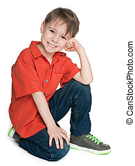 Laughing little boy in the red shirt