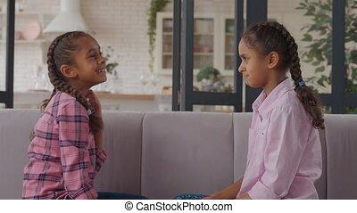 Laughing little girl bullying upset older sister - Cute ...