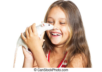 laughing little girl holding a pet rat