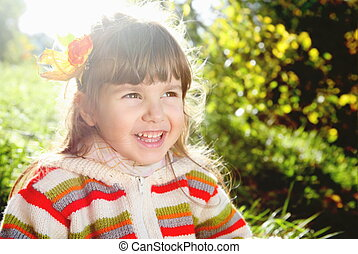 Laughing Little Girl Outdoors on Sunny Day